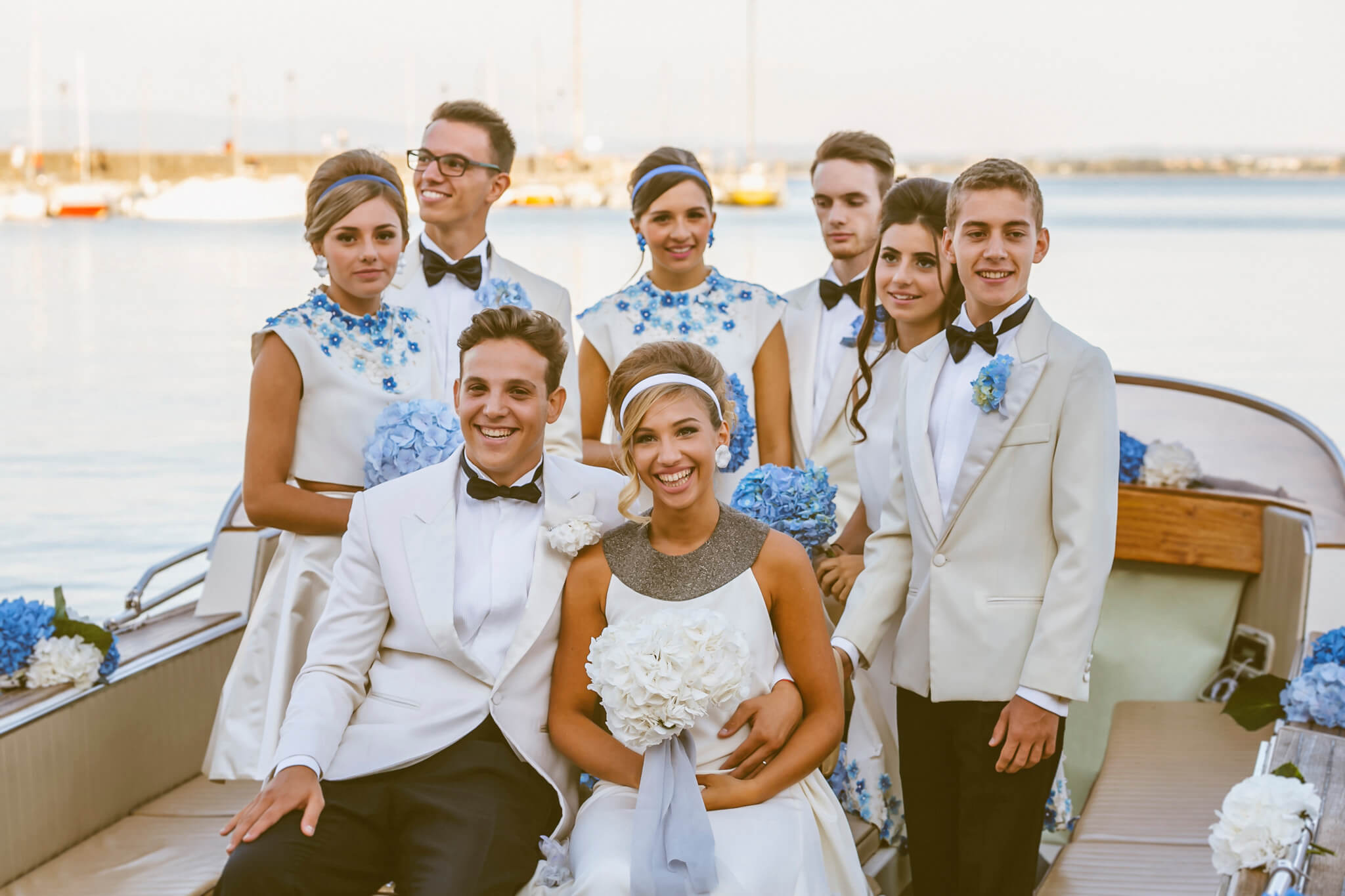 How to organize a styled photoshoot. Luca Ranja photography, wedding on a motor boat, bride, groom and wedding guests
