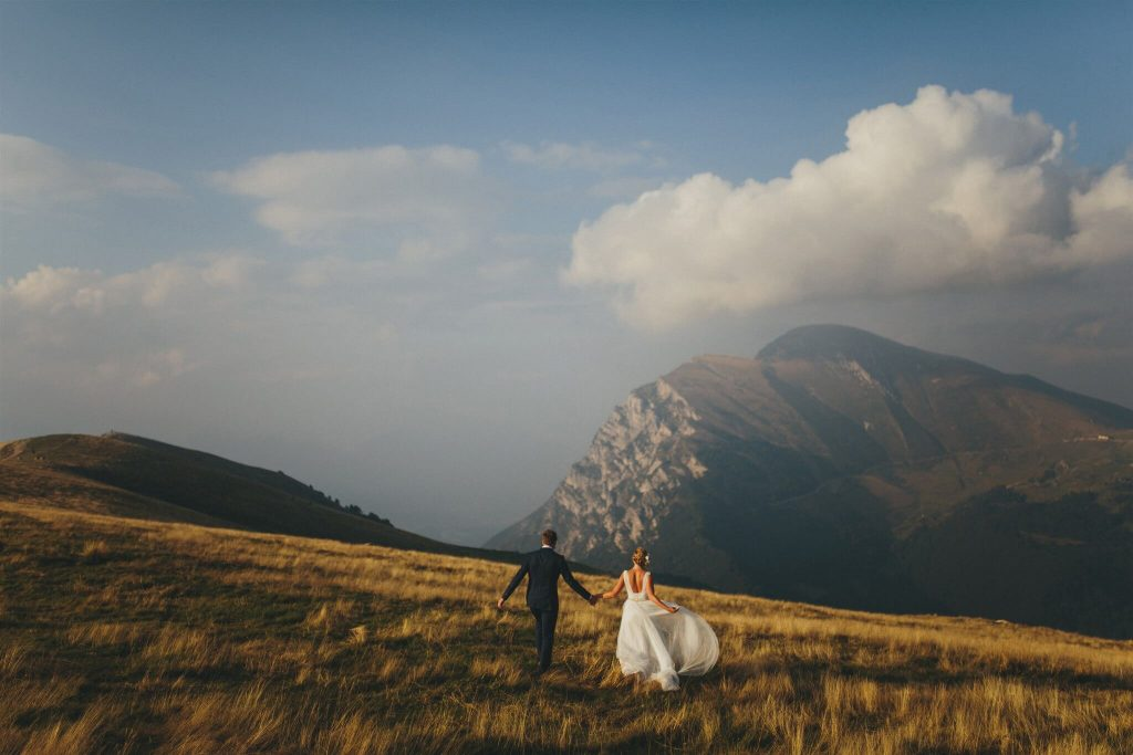 bride & groom on golden field, photo by Petar Jurica