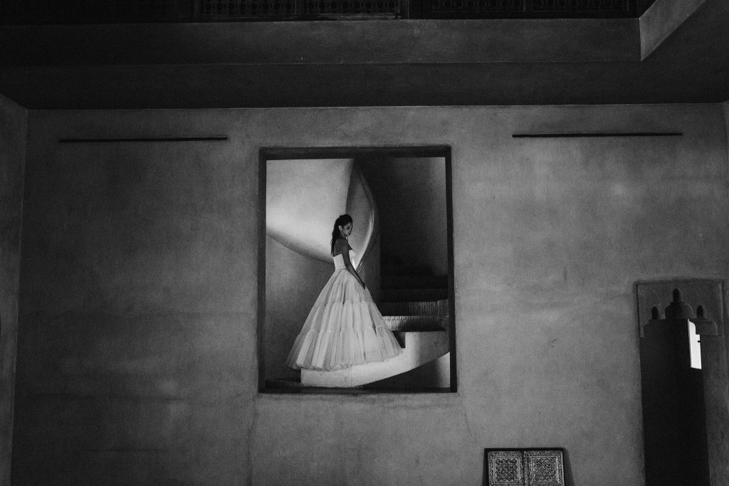 b&w bride portrait in mirror by Petar Jurica