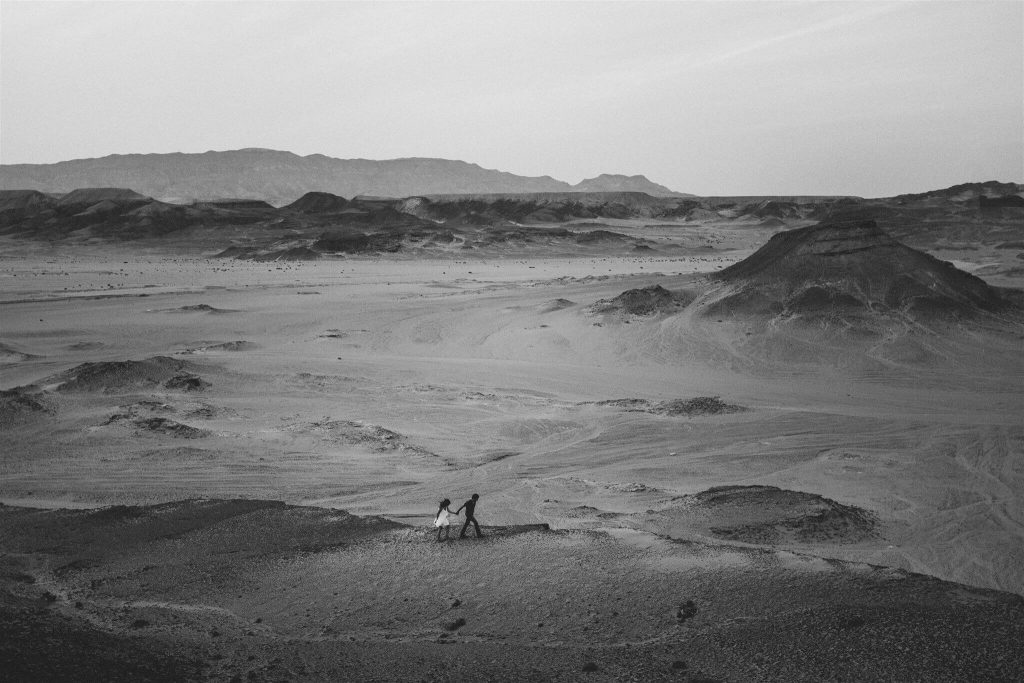 Couple strolling in desert, b&w. Petar Jurica