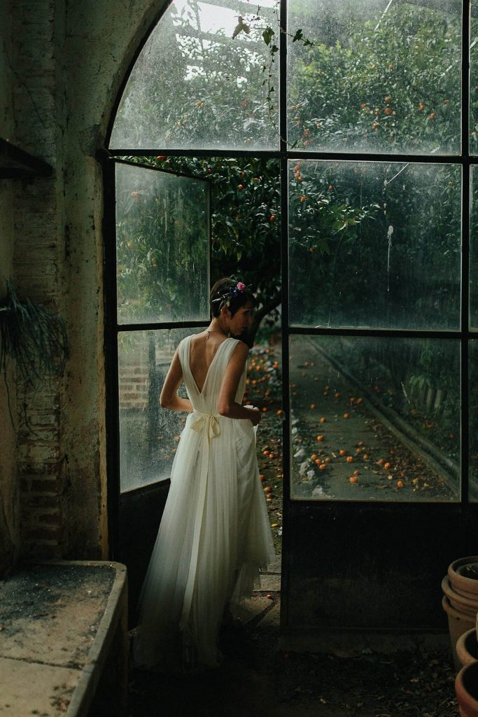 Moody Portrait of bride in greenhouse by Petar Jurica