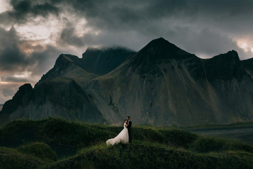 wedding portrait in epic mountain scenery, green, by Petar Jurica