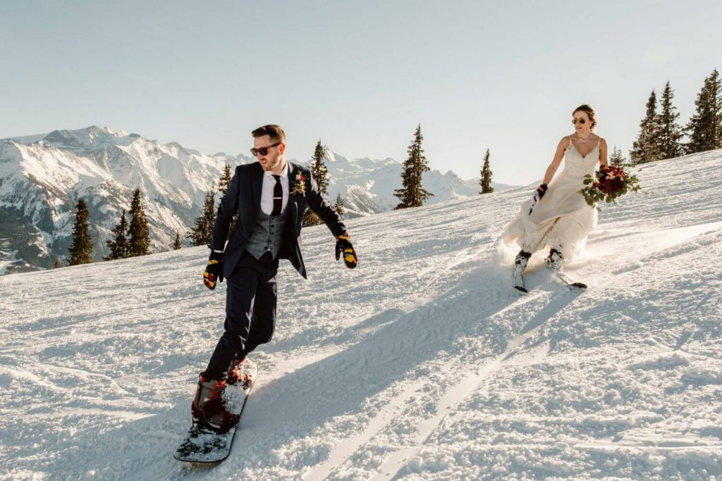 Bride and groom on ski in snow Cat Ekelboom White Wild Connection Photography