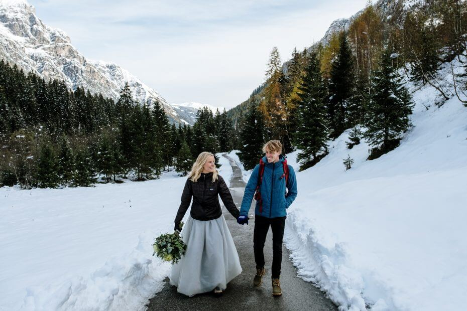 wedding while hiking in snowy mountains  Cat Ekelboom White Wild Connection Photography